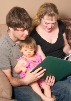 Family looking at scapbook together