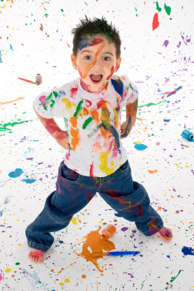 toddler covered in paint