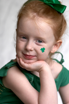 adorable girl with four leaf clover on cheek