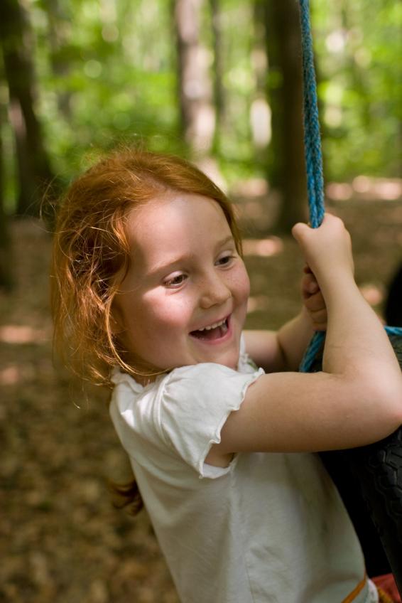 Girl confidently climbing rope