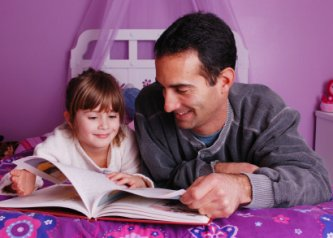 Bedtime Stories - dad reading a bedtime story to his daughter