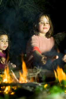 girls enjoying campfire