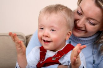 child with down syndrome and his mom