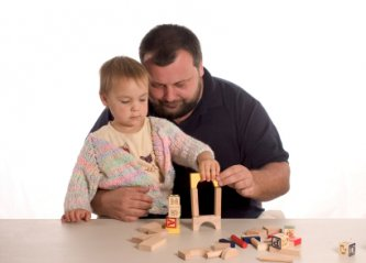 dad and son playing blocks