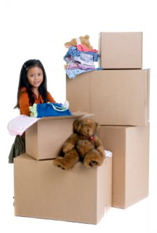 little girl helping to pack up her room