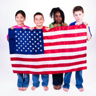 patriotic children holding a flag