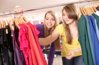 two young teenage friends shopping
