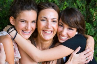 mother with her two teenage daughters