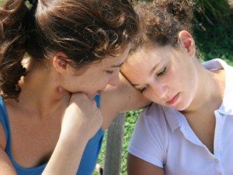 sad teenage girl being comforted