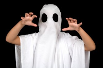 child playing ghost this halloween