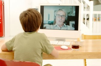 boy talking to dad on computer