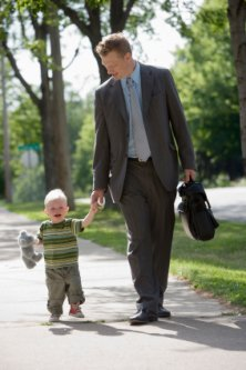 dad and small son walking together