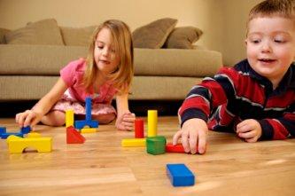 toddler sharing his blocks