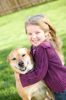a little girl and her pet dog