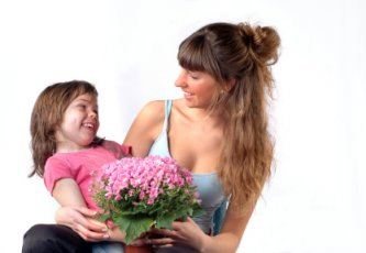 girl giving flowers to mom on Mother's day