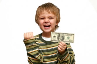 this little tyke really loves money