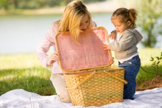 mommy and daughter enjoying a picnic together