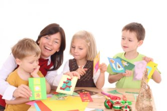 kids making Christmas cards with mom