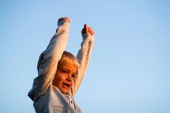 very happy self-confident little boy