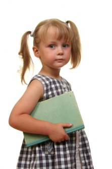 serious little girl on her first day of school
