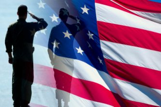 soldier saluting flag - remember our troops this Memorial Day