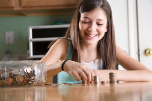 Young Teen Girl Counting Money