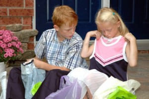 children looking at their clothes after a day of shopping