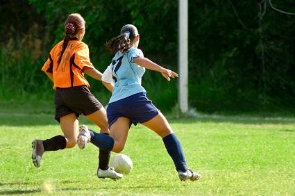 teen-girls-playing-soccer