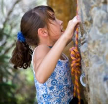 With Goal in Sight – Young Girl Climbing