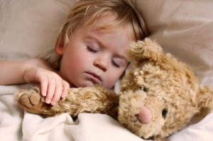 baby toddler asleep with teddy bear