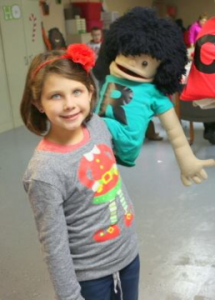 Kaitlyn Anderson with her puppet
