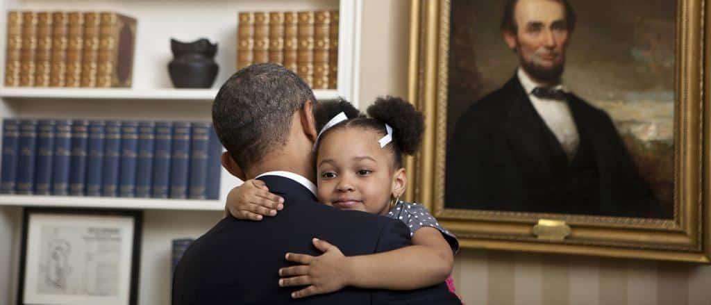Girl hugging President Obama